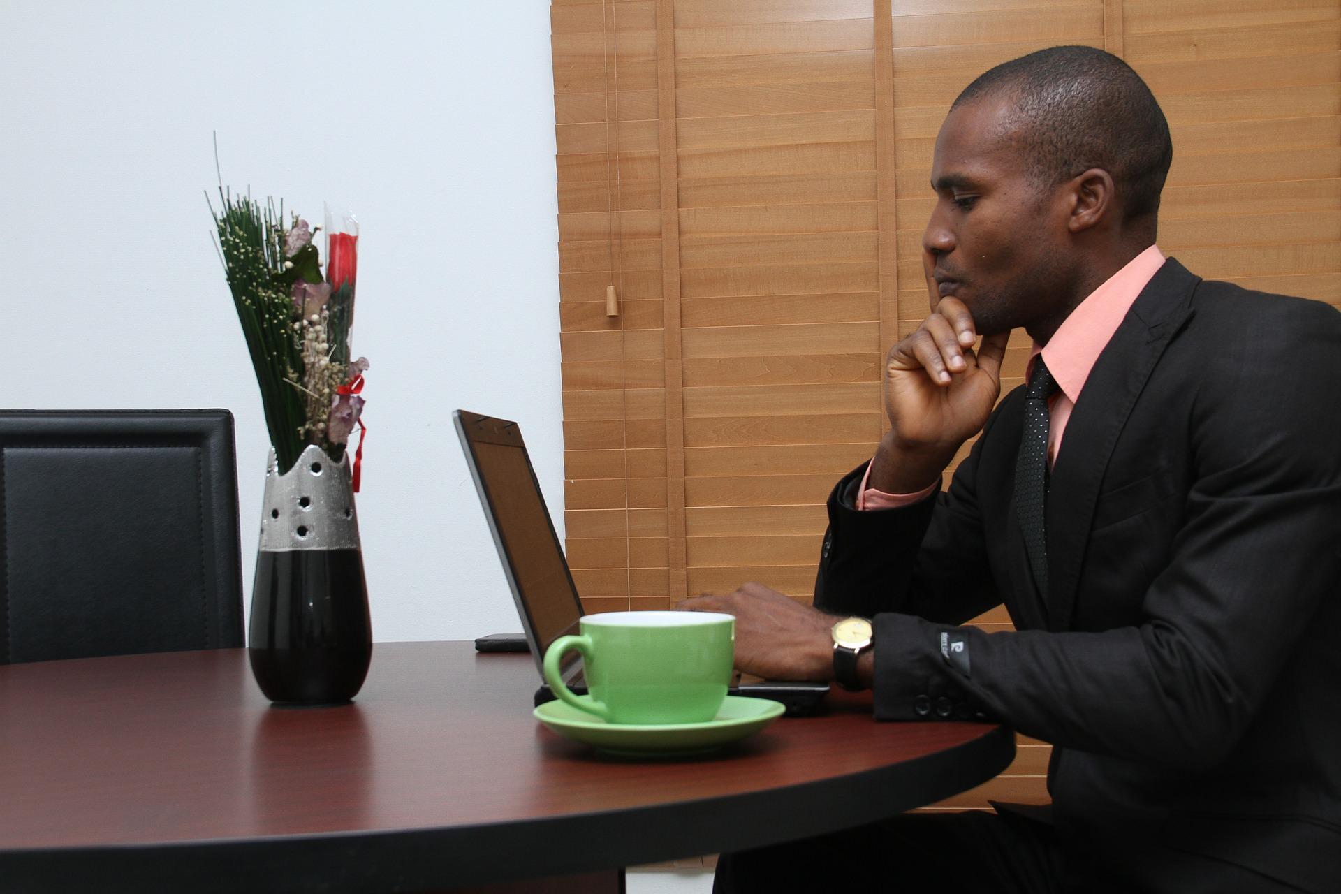 DevTel Employee On His Laptop