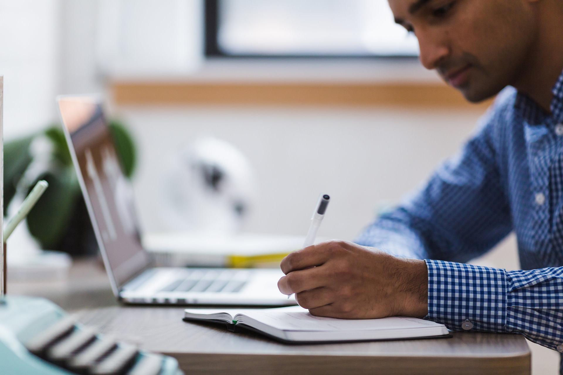 DevTel Employee Taking Notes